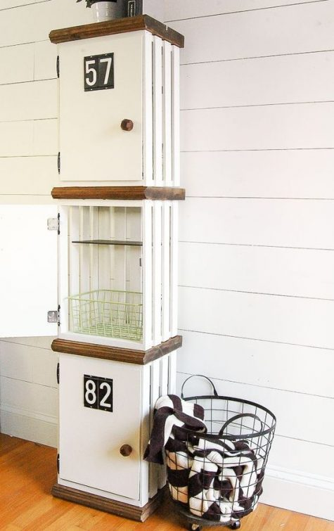 elegant white crate lockers with numbers are a chic and cool DIY for any laundry or mudroom