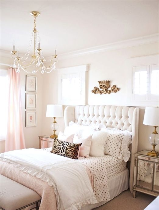 a cute and glam girlish bedroom is completed with a creamy wingback headboard, which is tufted for a more chic look