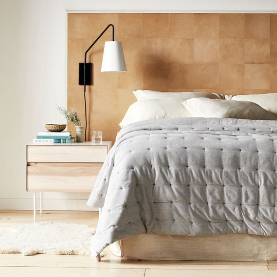 a stylish leather square headboard is a chic and warmign up idea that can be easily DIYed by you