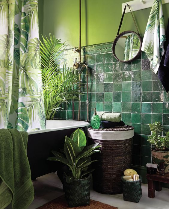 dark green tiles paired with light green wall, lots of greenery and a tropical print curtain for a tropical feel