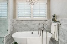 white bathroom design with cool light spheres