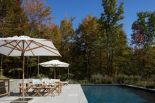 09 The outdoor space is done with a vast terrace, an outdoor dining space and a large pool