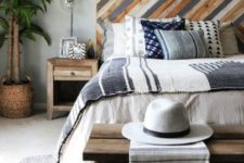 09 a bright wooden headboard done with a pattern and muted colors to add a relaxed boho feel to the bedroom