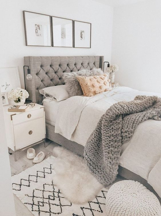 a grey wingback tufted headboard is a stylish and timeless idea that will fit a contemporary bedroom