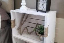 09 a white crate shelving unit on casters highlighted with yarn is a stylish idea with a rustic feel