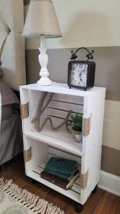 a white crate shelving unit on casters highlighted with yarn is a stylish idea with a rustic feel