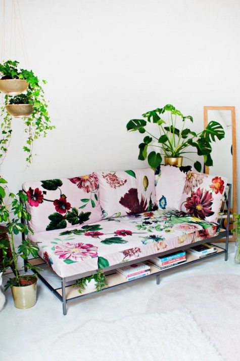an IKEA Ekebol couch hack with bright floral print fabric is an amazing idea for a summer living room