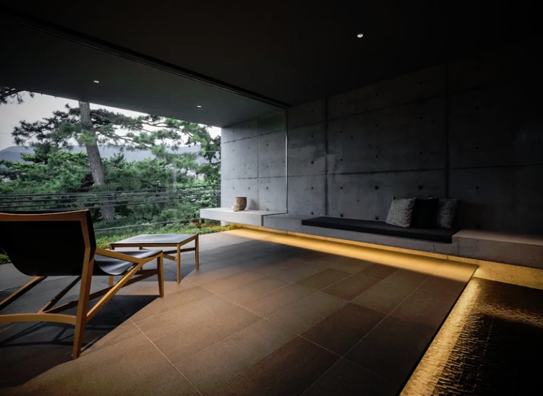 The living room looks moody and relaxing, as if you are in a spa