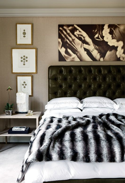 a black leather tufted headboard for a chic and elegant touch to this refined sleeping space
