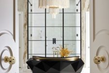 10 a jaw-dropping bathtub with a faceted design and a statement chandelier over it for a bold combo