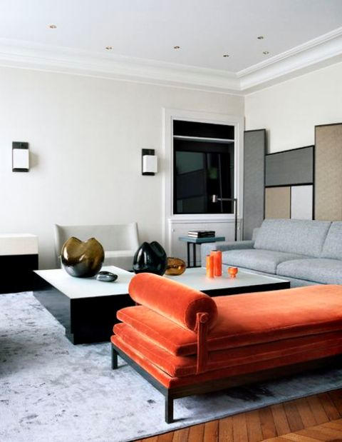 a minimalist interior with a colorful statement - an orange velvet daybed