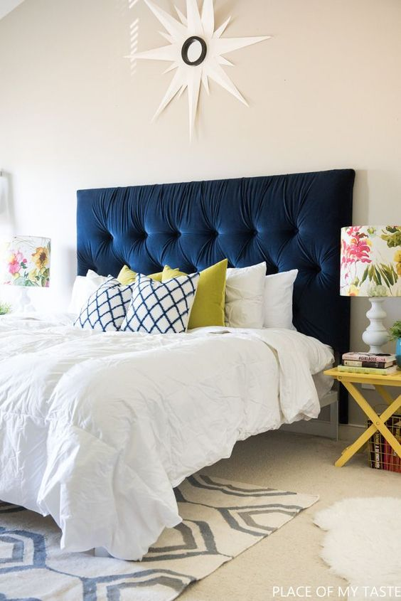 a navy tufted headboard is a bold statement in the neutral bedroom and a chic and timeless decor idea