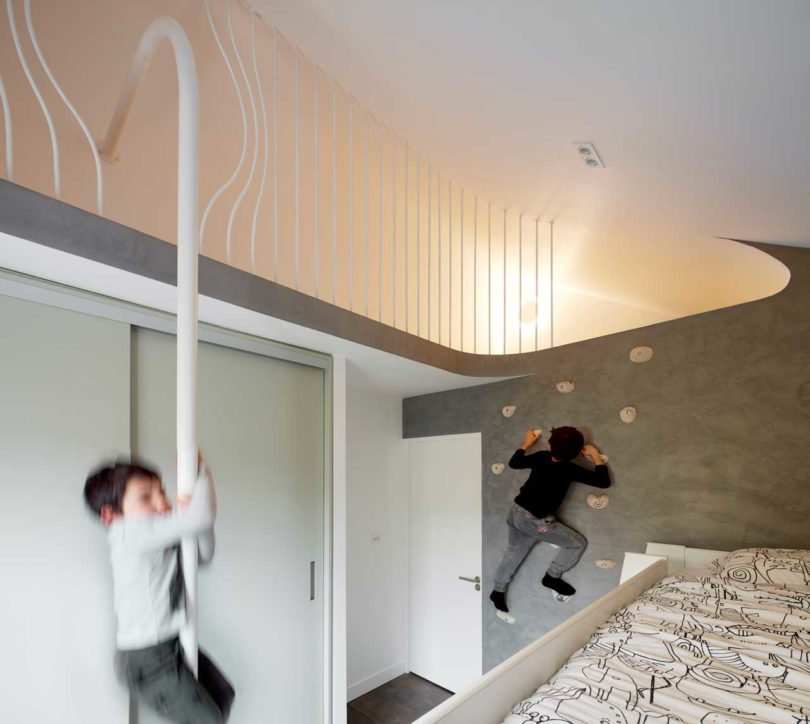 One kids' room features a climbing wall and other activity items for fun