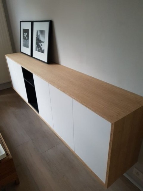 a chic contemporary floating credenza of IKEA Metod and Tutema cabinets plus a light colored wooden cover