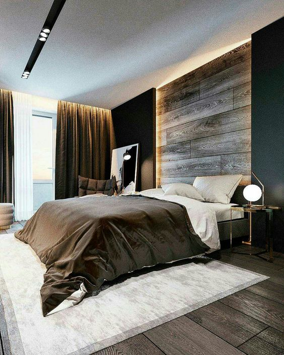 a sleek weathered wood headboard coming up to the ceiling and accented with LED lights from each side