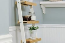 11 a space-saving ladder storage unit made of Ikea towel holders and some wood on them