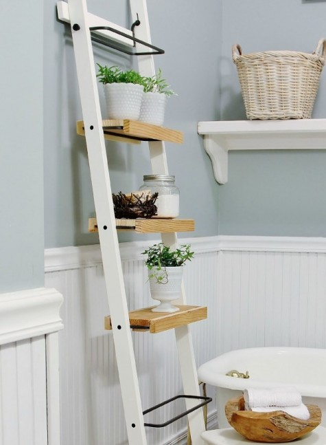 a space-saving ladder storage unit made of Ikea towel holders and some wood on them