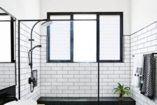 11 a stylish black and white bathroom done with white subway tiles and black hexagon ones
