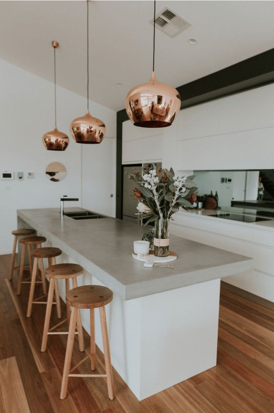 copper pendant lamps add a metallic touch and make the kitchen look bold, chic and catchy