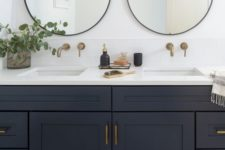 11 elegant brass and glass bubble lights over the vanity and over the sinks are great tasking lights