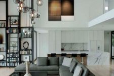 11 hanging glass pendant lamps at different height will make a bold statement and bring light