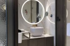 12 a minimalist bathroom with built-in lights in the mirror and wall around the vanity looks super chic and amazing