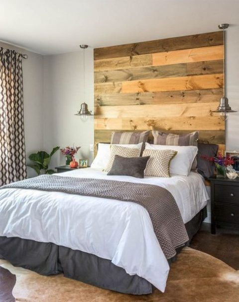 a reclaimed wood headboard coming up to the ceiling makes a statement and adds texture