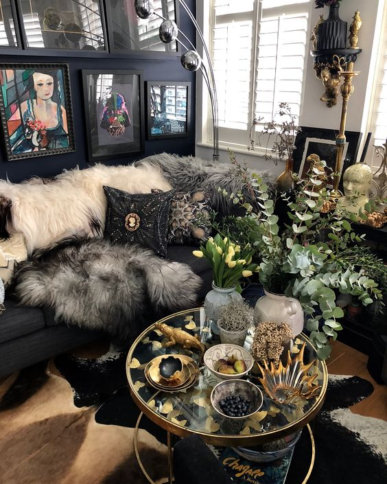 a shiny boho living room with faux fur throws and embellished and embroidered pillows