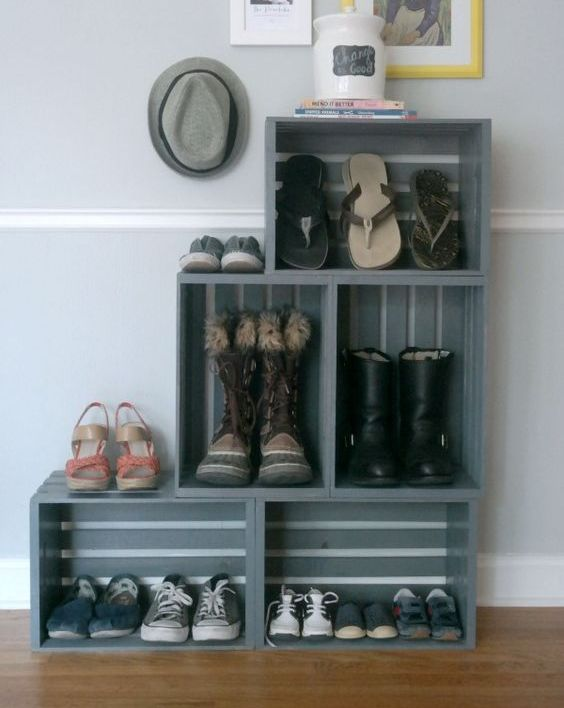 a turquoise bookshelf fully made of crates placed on vintage legs is a stylish rustic furniture piece