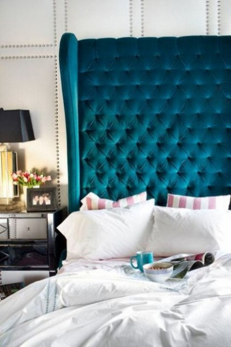 a tall dramatic teal wingback diamond upholstery headboard will make a colorful accent and add elegance to the space