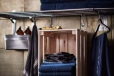 12 an IKEA Knagglig box hung on hooks and used as a towel holder is a creative idea to add a bit of storage space