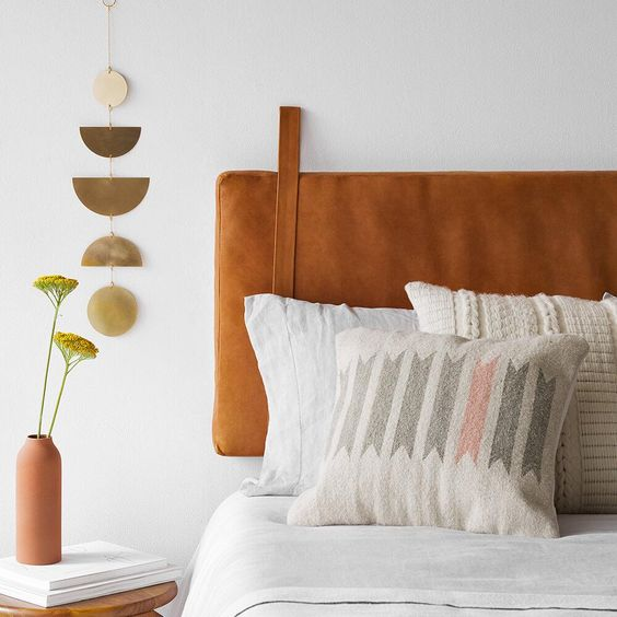 an amber hanging leather headboard is a trendy modern idea that can be easily added to any bed