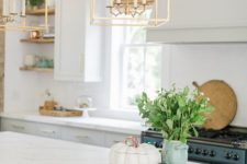 12 chic and elegant modern takes on traditional candle chandeliers with framing brign a wow effect to the space