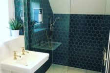 12 navy hexagon tiles accented with white grout are paired with large scale neutral tiles