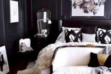 13 a chic bedroom with black paneled walls is brightened up with a white ceiling and creamy furniture and touches