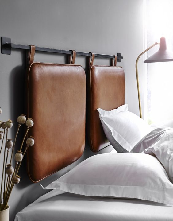 a hanging leather duo hheadboard in brown is a stylish way to accentuate a contemporary or minimalist bedroom