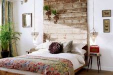 13 a weathered wood headboard that is extended to the ceiling to have a bigger impact