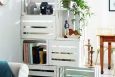 13 a white crate shelving unit doubles as a space divider, it's a functional idea for any open layout