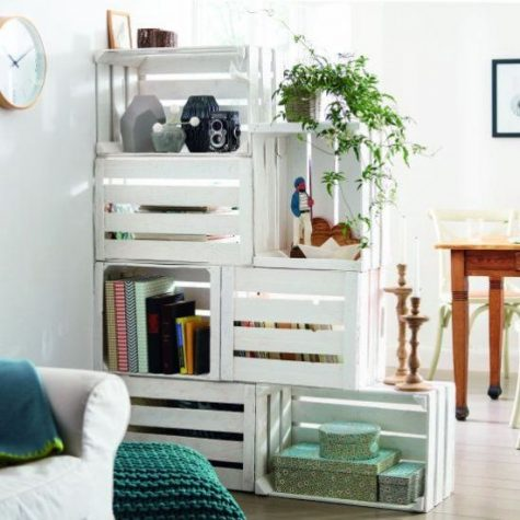 a white crate shelving unit doubles as a space divider, it's a functional idea for any open layout