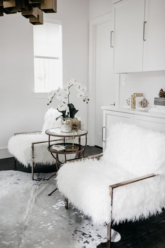 comfy chairs dressed up for the fall with white faux fur to make them cozier and softer