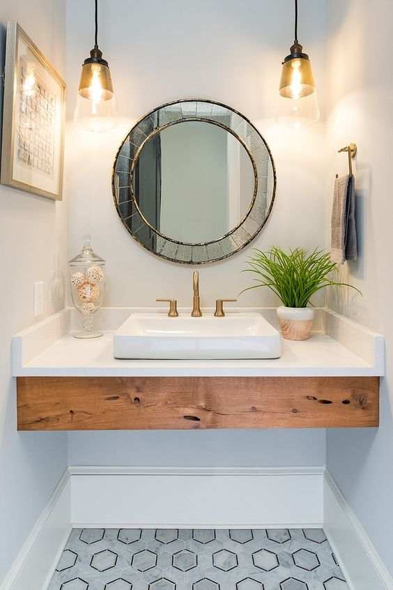 pendant lights over the vanity are a timeless idea for every bathroom, choose those that match the style