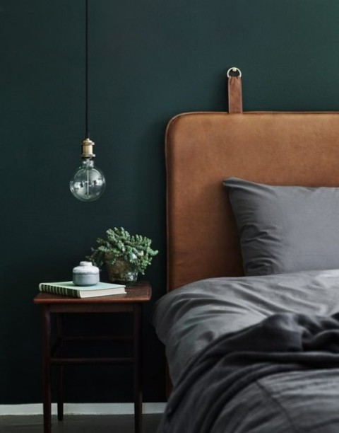 a brown leather upholstered headboard like this one is ideal for a man's bedroom