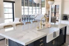 14 a chic farmhouse kitchen with elegant pendant two tone lamps on chains that highlight the mood and style