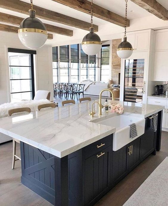 a chic farmhouse kitchen with elegant pendant two tone lamps on chains that highlight the mood and style