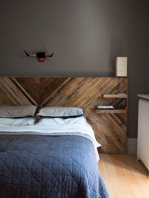 a chic reclaimed wood headboard with a herringbone pattern and tiny floating nightstand shelves for a touch of texture