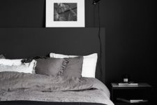 14 a contemporary meets Scandinavian bedroom with all blakc everything and some white touches to refresh the space