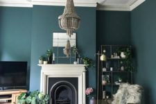14 a dark beaded chandelier accented with a ceiling medallion is a gorgeos contrasting idea for this moody room