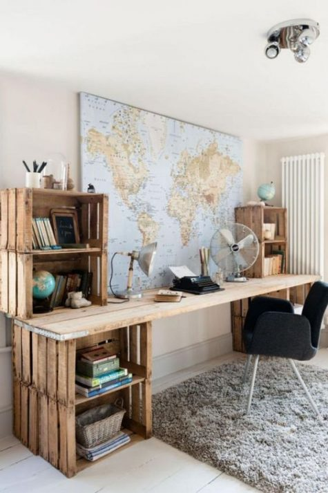 an oversized rustic desk made of crates and a long wooden plank tabletop is an easy DIY and its gives you much storage space