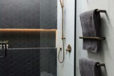 14 matte black hex tiles accented with neutrla grout and paired with large scale neutral tiles