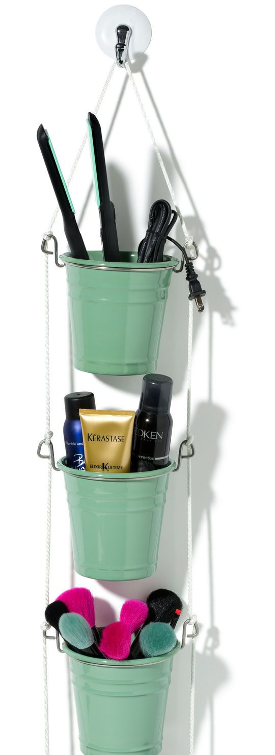 Ikea Fintorp Cutlery Caddies hung on ropes are used to store all the necessary makeup supplies